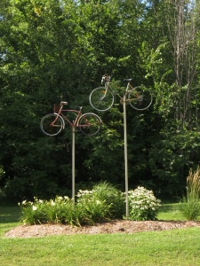 Bike sculpture beside road