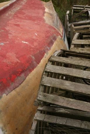 Lobster traps against boat hull