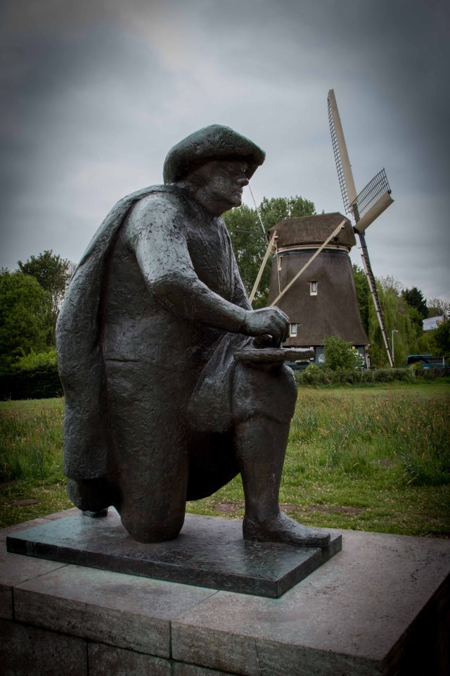 Statue of Rembrandt with windmill in background